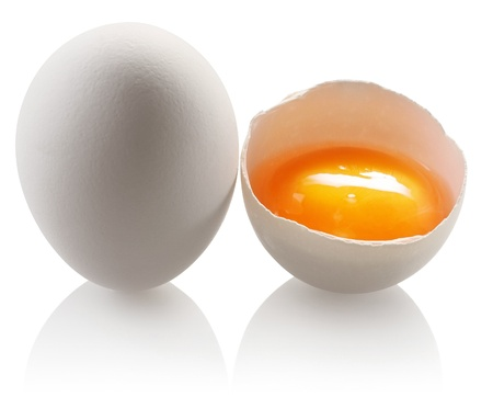 yolks: White egg and a half eggs on a white background