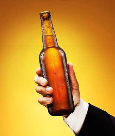Bottle of beer in a man Stock Photo - 13585485