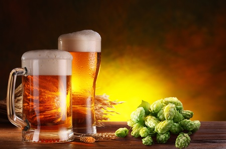 Still life with a keg of beer and hops  Stock Photo - 13585544