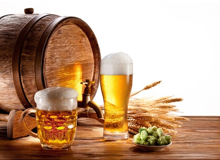 Beer barrel with beer glasses on a wooden table  Isolated on a white background  Stock Photo - 14040093