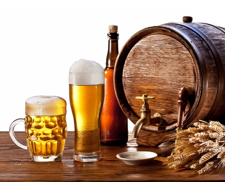 Beer barrel with beer glasses on a wooden table  Isolated on a white background  photo