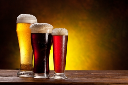 Beer barrel with beer glasses on a wooden table  The dark background  photo