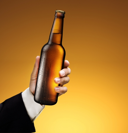 Bottle of beer in a man photo