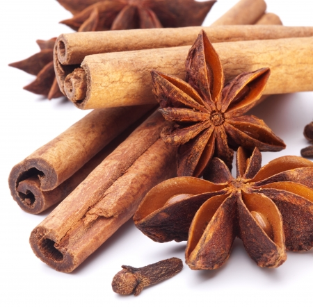 flavorings: Cloves, anise and cinnamon isolated on white background