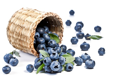 bilberries: Blueberries fall of the basket. Image on white background. Stock Photo