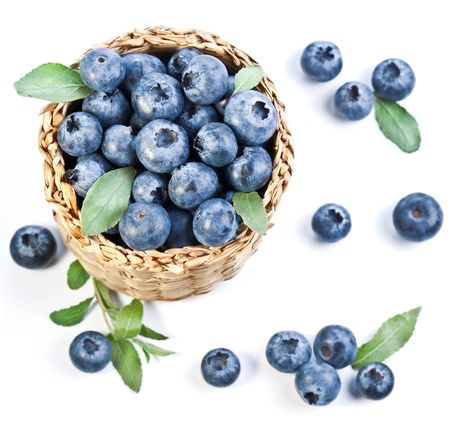 bilberries: Blueberries in a basket on a white background.