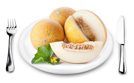 Melons with slice on a plate. Image on white background. photo