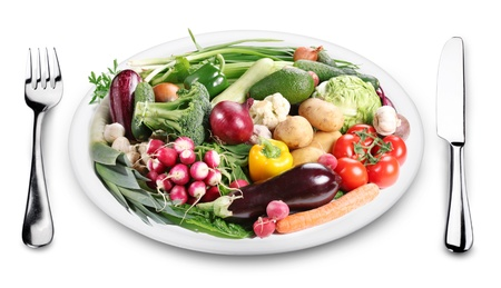 Lots of vegetables on a plate. Image on white background. photo