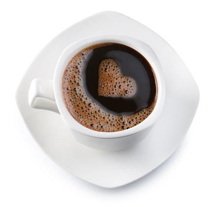 morning coffee: Coffee cup and saucer on a white background. Foam in the form of the heart. File contains the path to cut. Stock Photo