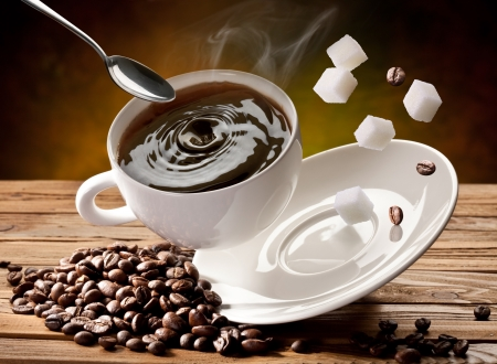falling cubes: Falling  cup coffee, spoon and sugar cubes are falling down also.