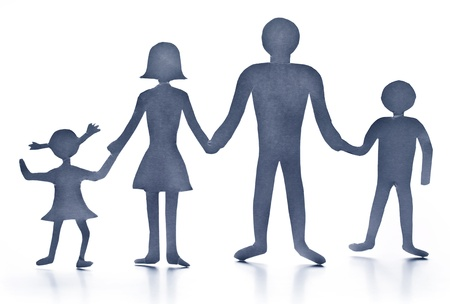 Cardboard figures of the family on a white background. The symbol of unity and happiness. photo