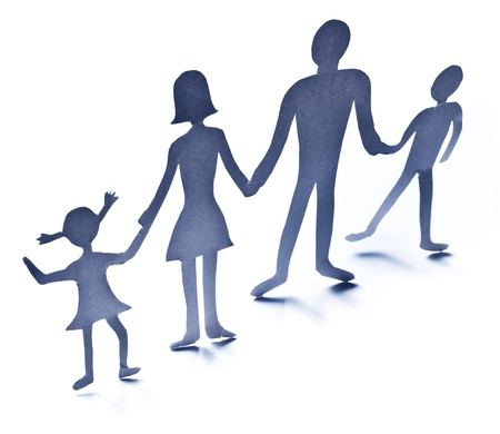 Cardboard figures of the family on a white background. The symbol of unity and happiness. Stock Photo - 14878973