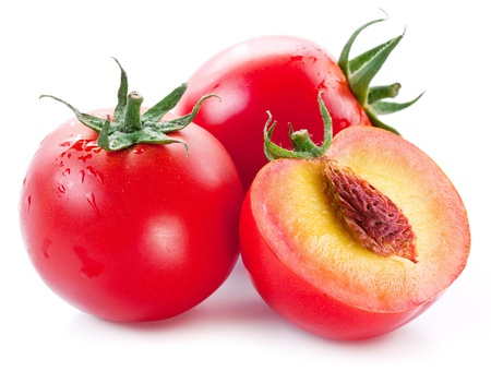 flesh: Flesh tomatoes cut ripe peach. Product of genetic engineering. Computer assembly.  Stock Photo