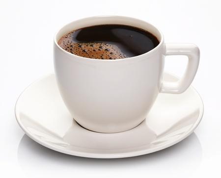 drinking coffee: Taza de caf� y platillo en un fondo blanco.