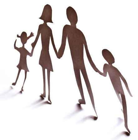 linked together: Cardboard figures of the family on a white background. The symbol of unity and happiness. Stock Photo