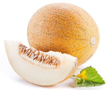 Melon with slices and leaves on a white background. Imagens