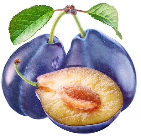 Plums with a slice and leaf on a white background. photo