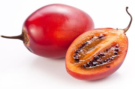 tamarillo: Tamarillo fruits with slice on white background. Stock Photo
