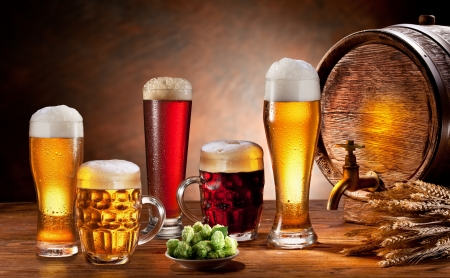 Beer barrel and draft beer by the glass  Dark background  photo