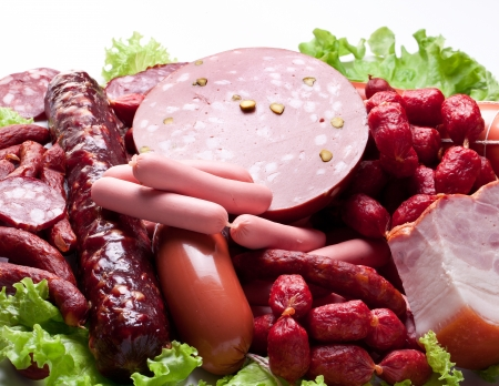 salami sausage: Meat and sausages on lettuce leaves   Isolated on white background from above