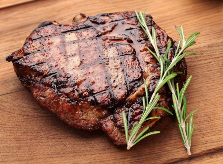 grilled steak: Beef steak on a wooden table  Stock Photo