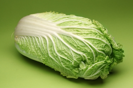 Chinese cabbage isolated on a green background