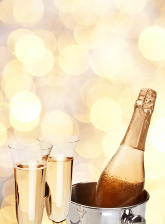 celebration champagne: Two champagne glass with bottle on a yellow blur background  Stock Photo