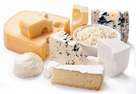 Various types of cheeses on a white background