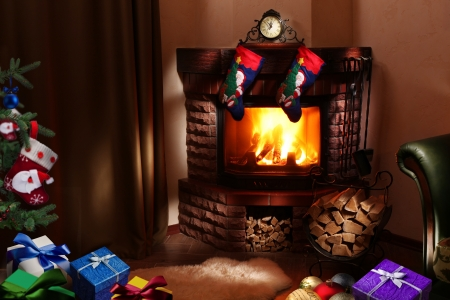 Christmas gifts by the fireplace  photo