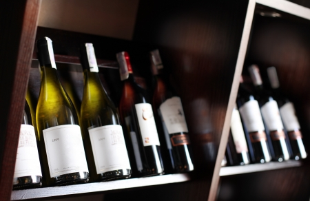 wine store: Wine bottles on a wooden shelf