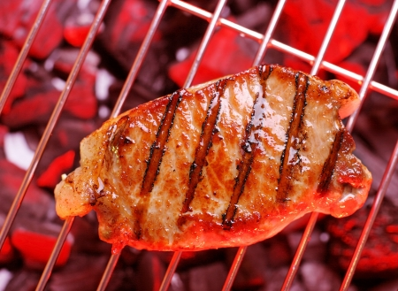 Hot  beefsteak on barbecue Stock Photo - 16156819