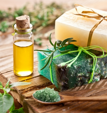Pieces of natural soap with oil and herbs. Stock Photo - 16156974