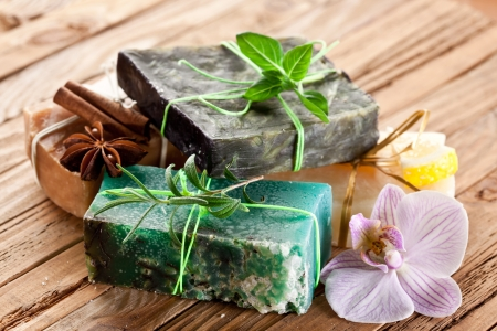 body care: Pieces of natural soap with herbs. Stock Photo