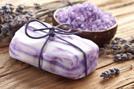 organic spa: Soap with sea-salt and dried lavender on wood desk. Stock Photo