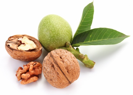 pith: Green walnut; peeled walnut and its kernels. Isolated on a white background. Stock Photo