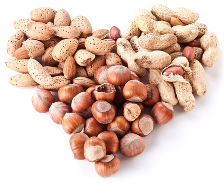 Nuts in the shape of heart isolated on a white background  Banco de Imagens