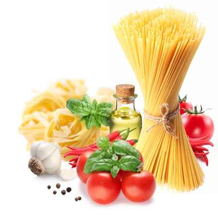 Pasta spaghetti, vegetables, spices and oil  Isolated on a white background  photo