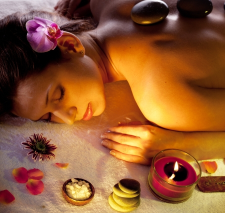 Young woman getting stones spa procedures Stock Photo - 16521050