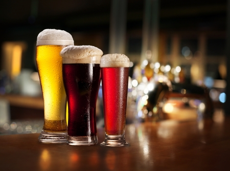Glasses of light and dark beer on a pub background  Stock Photo