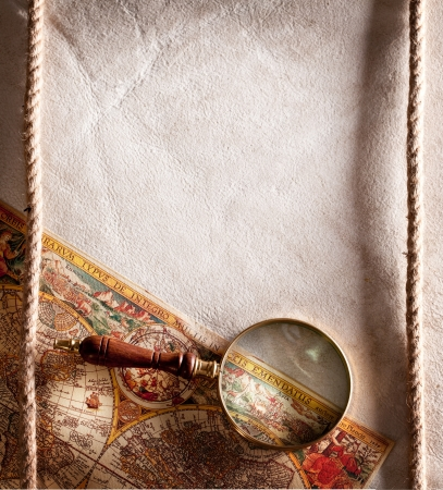 Magnifying glass on old parchment. Stock Photo - 16891673