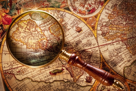Magnifying glass on old map. photo