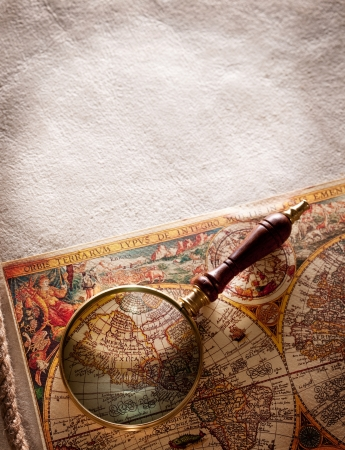 Magnifying glass on old parchment. photo