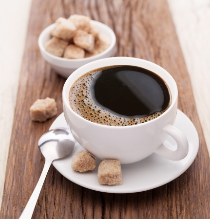 Cup of coffee with brown sugar on a wooden table  Stock Photo - 16971834