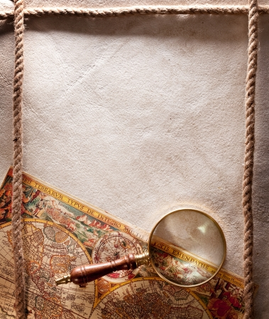 Magnifying glass on old parchment Stock Photo - 16971815