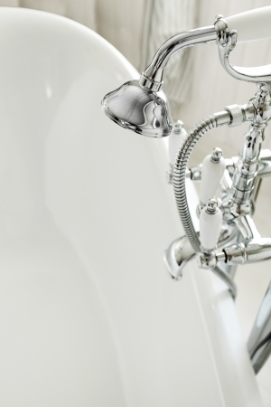 White bathroom with chrome shower  Close shot  photo