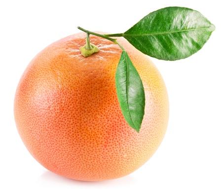 Pomelo con hojas sobre un fondo blanco Foto de archivo