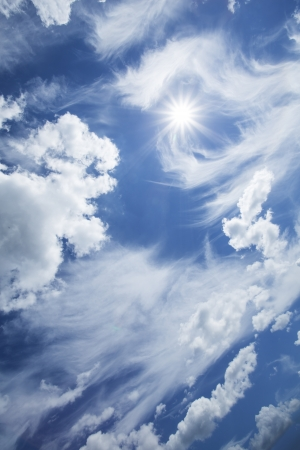Blue sky with clouds and sun Stock Photo - 17276790