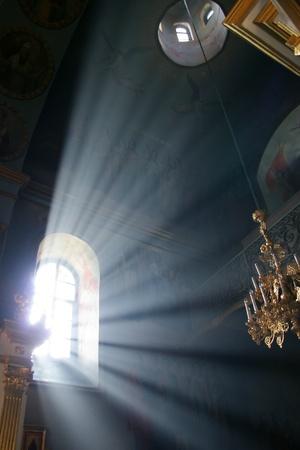 Church window with sunlight shining through