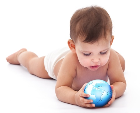 earth map: Little baby holds small globe in her hands  Isolated on a white background
