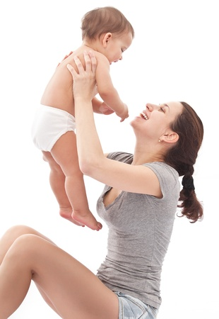 baby sit: Happy baby plays with mother  Isolated on a white background